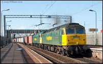 57011 and 57004 passing Bescot